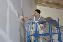 Patrick Hill taping the big wall of the lobby